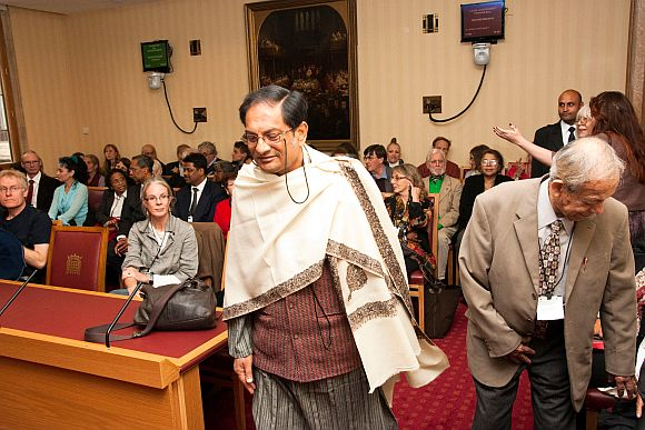 Dr Sen gets up to receive the award at the ceremony in House of Lords