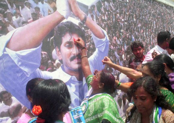 Women activists celebrate the victory of YSR Congress in the AP by-poll