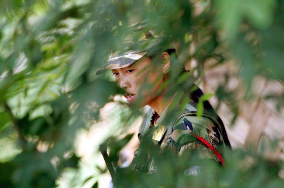 A Naga rebel stands guard at the Hebron Camp in Nagaland