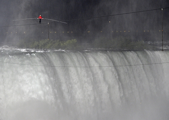 Tightrope walker Nik Wallenda walks the high wire from the US side to the Canadian side over the Horseshoe Falls in Niagara Falls, Ontario