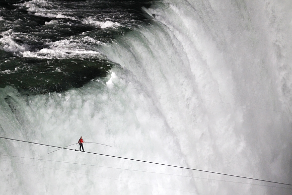 Wallenda walks the high wire over the Horseshoe Falls in Niagara Falls