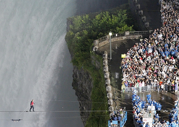 Wallenda walks the high wire