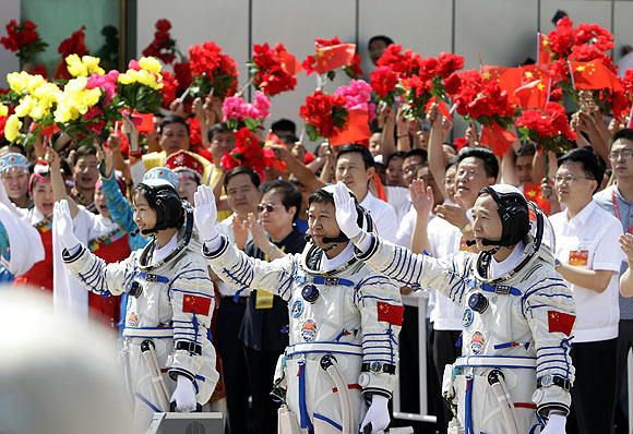 Chinese astronauts ahead of the departure ceremony at Jiuquan Satellite Launch Center