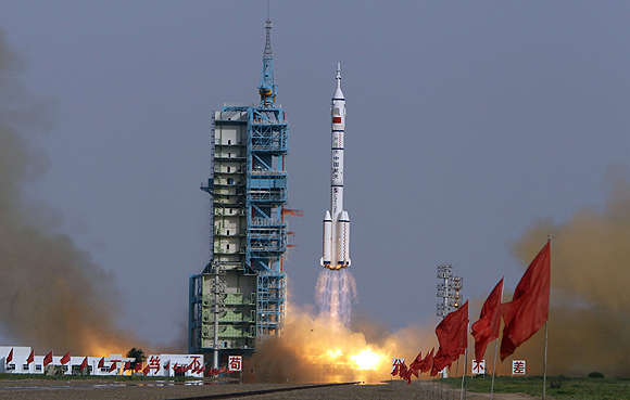 The Long March II-F rocket loaded with a Shenzhou-9 manned spacecraft carrying Chinese astronauts Jing Haipeng, Liu Wang and Liu Yang lifts off from the launch pad in the Jiuquan Satellite Launch Center