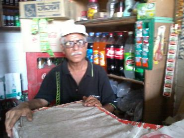 Grocery store owner, Deena Nath Grover