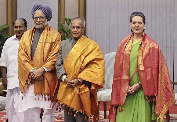 Finance Minister Pranab Mukherjee flanked by Prime Minister Manmohan Singh and Congress president soon after he was named as the UPA's presidential candidate. To the extreme left is Defence Minister AK Antony