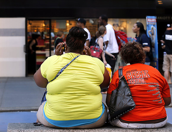 Women sit on a bench in New York's Times Square