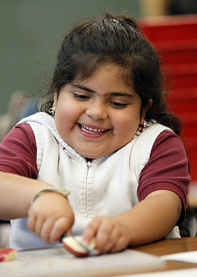 A girl takes part in a healthy meal initiative