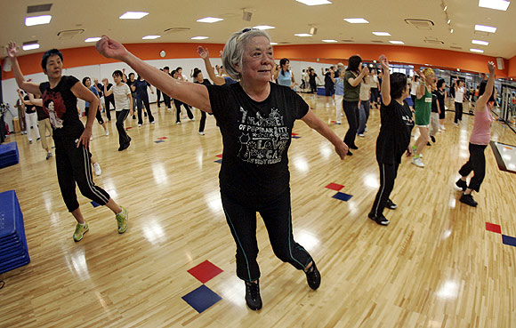 Women take part in an aerobics class at a gym in Tokyo