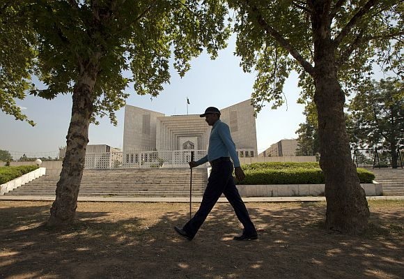 A policeman walks past the supreme court in Islamabad