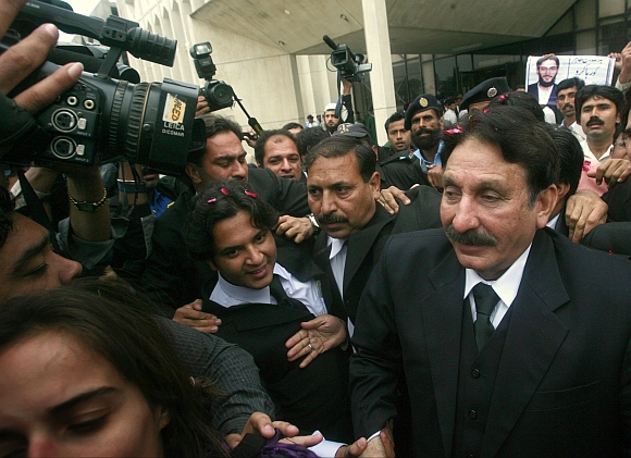 File photo of Supreme Court Chief Justice Iftikhar Chaudhry is surrounded by media and well wishers as he walks toward his offices in Islamabad