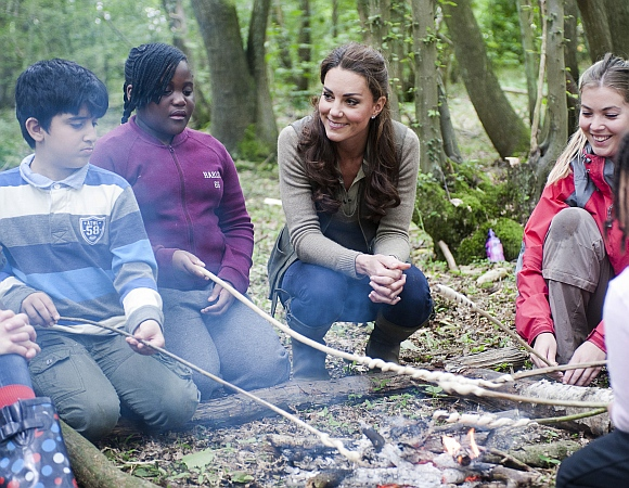 Britain's Catherine, Duchess of Cambridge speaks to children during a visit to the 'Expanding Horizons' Primary School Project in Wrotham, southern England