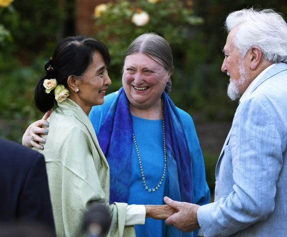 Aung San Suu Kyi speaks with old friends during a reception at Oxford University
