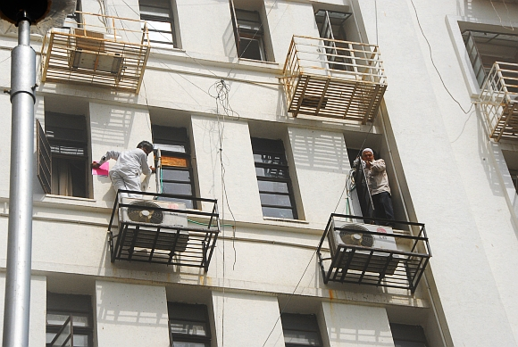Office workers came out of their windows in a desperate attempt to escape the smoke and the fire