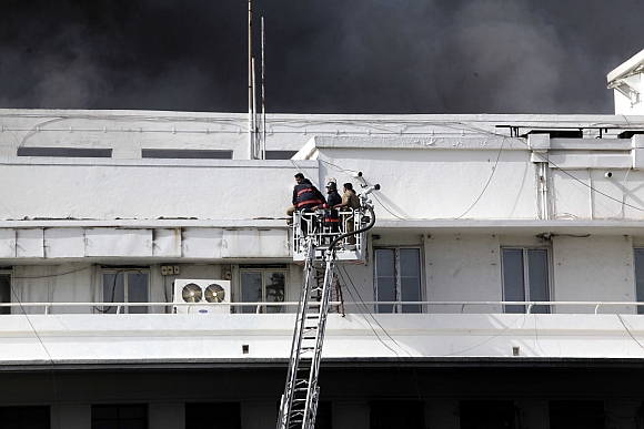 Firemen rescue those trapped in the fire at Mantralaya