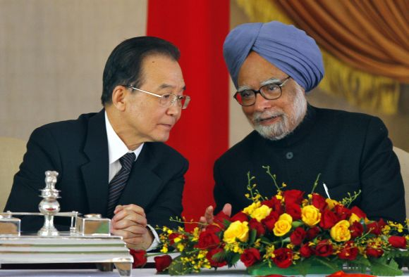 Chinese PM Wen talks to Manmohan Singh during a signing of agreements ceremony in New Delhi in December, 2010