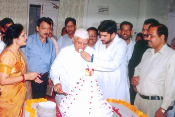 Shekhar feeds Tiwari a piece of cake on the latter's birthday