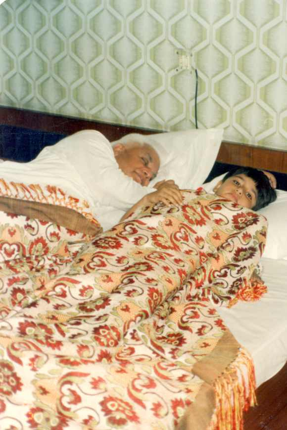 Tiwari sleeps as a teenaged Rohit Shekhar looks on