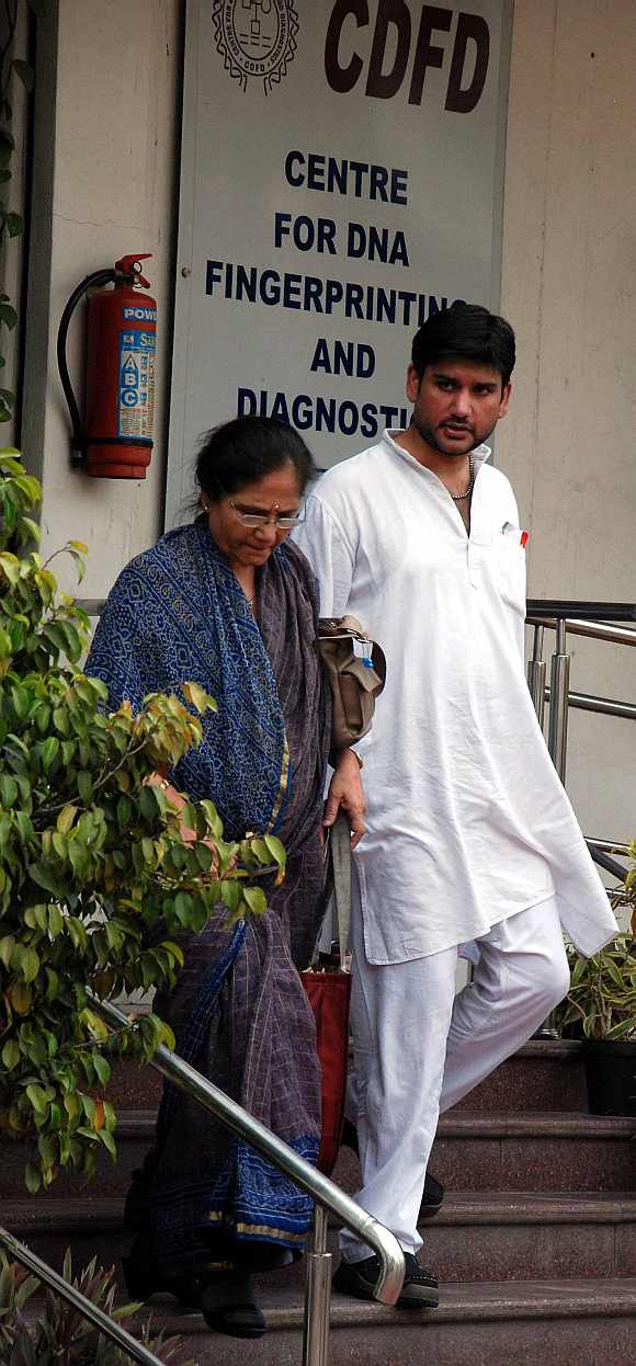 Rohit Shekhar and his mother Ujjawala Sharma exit the centre for DNA fingerprinting and diagnostics laboratory in Hyderabad
