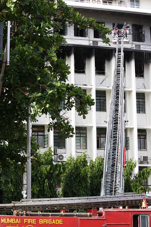 Smoke rises from the Mantralaya offices as firefighters struggle to douse the flames