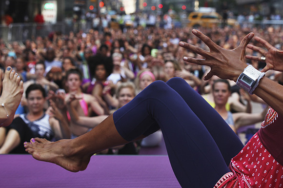People practice yoga in New York's Times Square