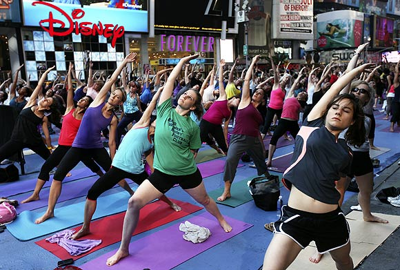 New Yorkers stretch as they practise yoga