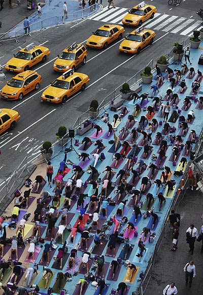 New Yorkers transform Times Square into yoga village