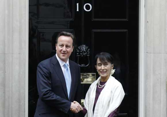 Britain's Prime Minister David Cameron greets Myanmar pro-democracy leader Aung San Suu Kyi in Downing Street in London