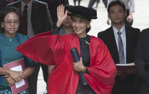 Suu Kyi leaves through The Great Gate after receiving her honorary degree at Oxford University, in Oxford southern England