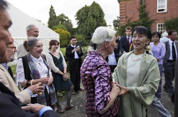 Suu Kyi speaks with old friends during a reception at Oxford University