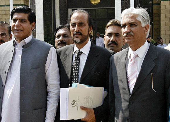 Members of the Pakistan People's Party (L-R) Raja Pervez Ashraf, Babar Awan and Nayyar Bokhari