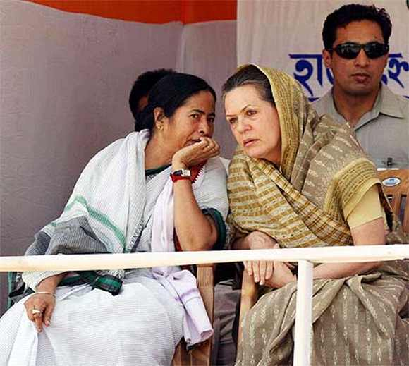 Banerjee interacts with Congress President Sonia Gandhi duringa a rally