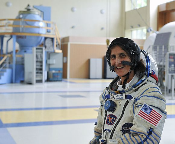 Sunita Williams smiles during a training exercise at the Star City space centre outside Moscow.