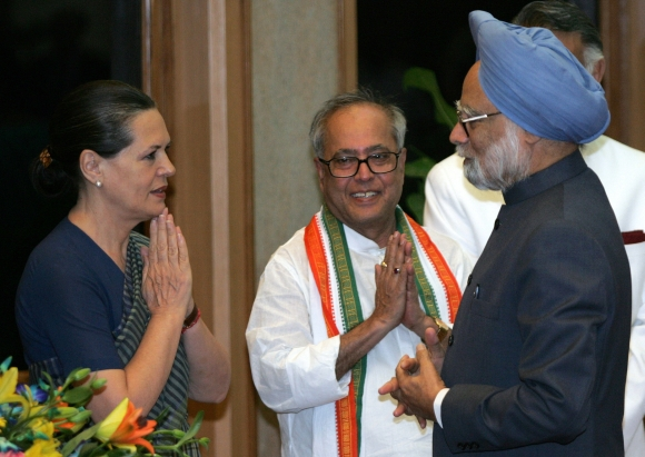Finance Minister Pranab Mukherjee with Congress chief Sonia Gandhi and Prime Minister Manmohan Singh