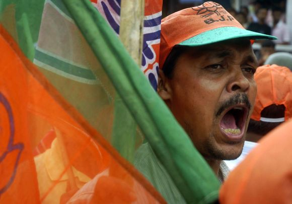 A BJP activist shouts slogans during a protest demonstration