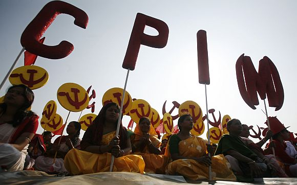 Supporters of CPI-M attend a public rally at Agartala