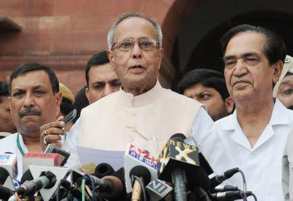 Mukherjee addresses the media after stepping down as finance minister