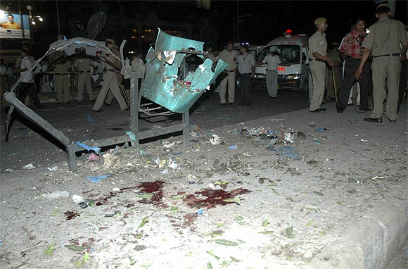 Policemen inspect one of the blast sites in Delhi in September, 2008