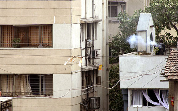 A NSG commando fires at terrorists inside Nariman House in November, 2008