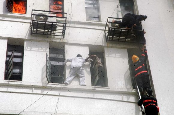 A stranded person trying to make his way out from the burning Mantralaya as firefighters continue rescue operations