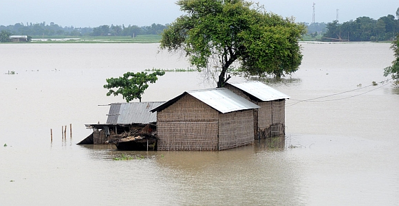 Submerged houses at Ashigarh village in Morigoan district, about 80 Km from Guwahati