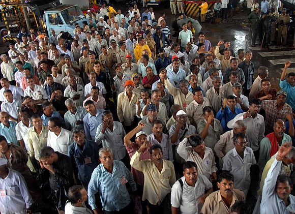 Mill workers protesting at the main arterial road in Bandra, Mumbai