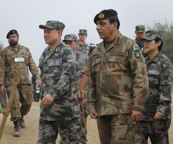 Pakistani Army Chief General Kayani walks with Chinese General Hou after meeting soldiers taking part in joint military exercises in Jhelum, in Pakistan's Punjab province