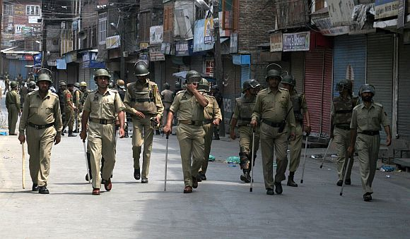 Strict restrictions and tight police vigil was put in place to foil a march to the gutted shrine in Srinagar on Friday