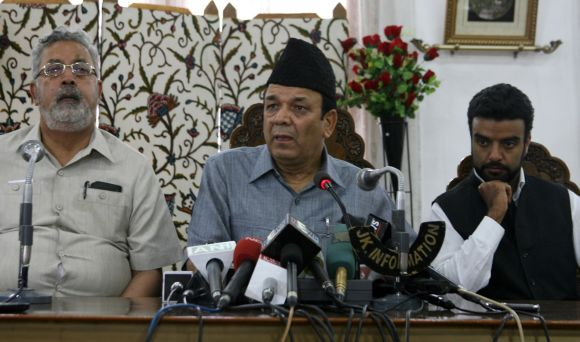 Jammu and Kashmir ministers speak to the media while putting forth the government's action plan to recreate the revered shrine in Srinagar