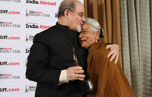 Renowned author Salman Rushdie greets Anita Desai, winner of the India Abroad Award for Lifetime Achievement