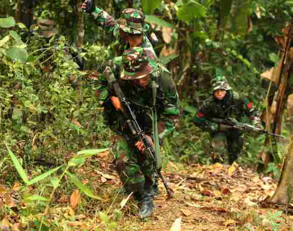 Soldiers during an insurgency and jungle warfare drill of Indian and Indonesian armies