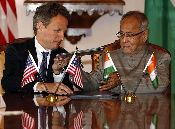 A file photo of US Secretary of Treasury Timothy Geithner and Finance Minister Pranab Mukherjee during the signing of the 2011 US-India Economic and Financial agreement
