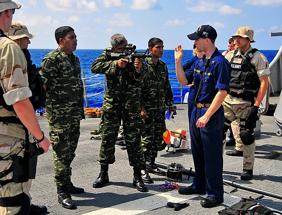 A US instructor with members of the Maldives National Defense Force Coast Guard
