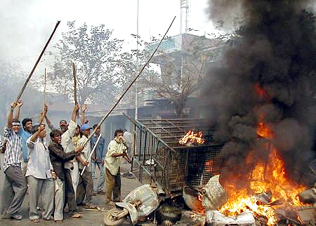 A file photo of angry crowds on a rampage in Ahmedabad, killing Muslims, in reprisal for the Godhra incident.